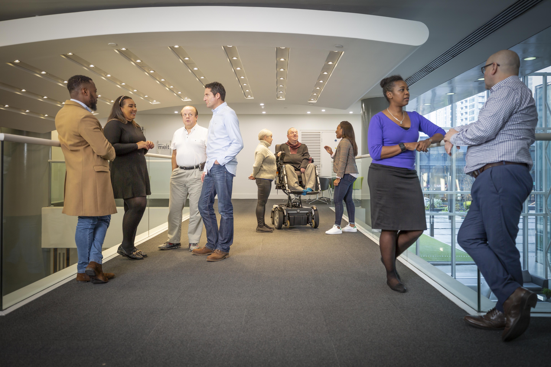 diverse staff standing talking